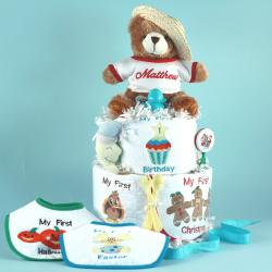 Baby's first holiday diaper cake is a personalized unisex baby gift that is perfect to welcome a newborn baby boy or girl.