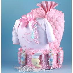 Bedtime for Baby Diaper Cake baby girl gift with diapers, sleep gown and other layette items.